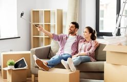 Couple taking picture by selfie stick at new home royalty free stock image