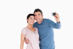 Couple taking a picture of themselves Royalty Free Stock Photos