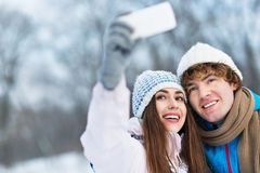 Couple taking picture of themselves Royalty Free Stock Photos