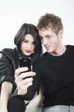 Couple taking pictures Stock Image