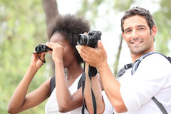 Couple taking pictures Stock Images