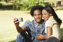 Couple taking pictures. Royalty Free Stock Images