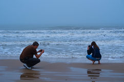 Couple Taking Pictures of the Surf. In Matagorda, Texas royalty free stock photos