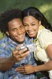 Couple taking portraits. Royalty Free Stock Photo