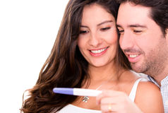 Couple taking a pregnancy test Royalty Free Stock Photos