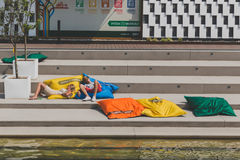 Couple taking a rest at Expo 2015 in Milan, Italy Stock Photos