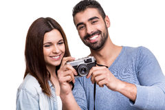 Couple taking retro camera photo Royalty Free Stock Image