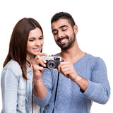 Couple taking retro camera photo Stock Photography