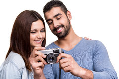 Couple taking retro camera photo Stock Image