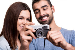 Couple taking retro camera photo Stock Photos