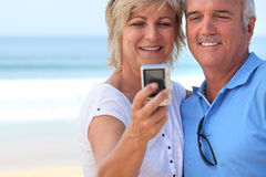 Couple taking self-portrait Stock Image