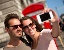 Couple taking a self portrait Stock Images