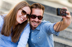 Couple taking a self portrait Royalty Free Stock Photos
