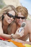 Couple Taking Self-Portrait On Beach Royalty Free Stock Photos