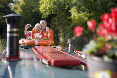 Couple taking self-portrait on boat Stock Photography