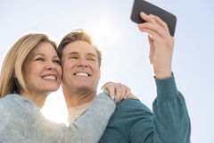 Couple Taking Self Portrait Through Cell Phone Stock Photo