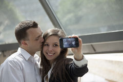 Couple taking self portrait with mobile phone Royalty Free Stock Image