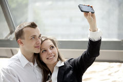 Couple taking self portrait with mobile phone Royalty Free Stock Photo