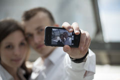 Couple taking self portrait with mobile phone Stock Photo