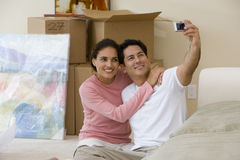 Couple taking self-portrait in new home Royalty Free Stock Images