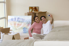 Couple taking self-portrait in new home Royalty Free Stock Photo