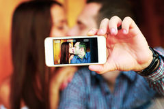 Couple taking self-portrait Royalty Free Stock Images