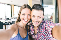 Couple taking self portrait with smart phone Stock Images