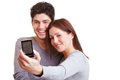 Couple taking self portraits Stock Image