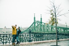 Couple taking selfe near old bridge in the morning. Couple taking selfe near old bridge in european city in the morning Stock Photos