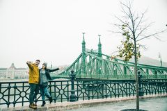 Couple taking selfe near old bridge in the morning. Couple taking selfe near old bridge in european city in the morning Stock Photography