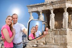 Couple taking selfie against Parthenon temple on Acropolis in Athens, Greece Stock Photo