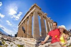 Couple taking selfie against Parthenon temple on Acropolis in Athens, Greece Stock Photo