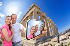 Couple taking selfie against Parthenon temple on Acropolis in Athens, Greece Royalty Free Stock Image