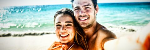 Couple taking a selfie. On the beach royalty free stock photo