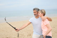 Couple taking selfie on the beach Royalty Free Stock Image