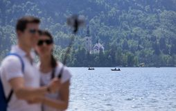 Couple taking selfie on Bled lake in Slovenia Royalty Free Stock Image