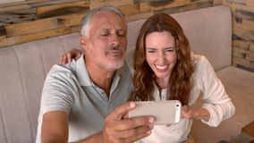 Couple taking a selfie in cafe stock footage