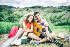 Couple taking selfie in a campsite Royalty Free Stock Images