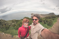 Couple taking selfie at Cape Point, Table Mountain National Park, scenic travel destination in South Africa. Fisheye view from abo. Ve royalty free stock photo