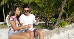 Couple Taking Selfie On Cell Smart Phone Outdoors Under Palm Trees, Happy Smiling Man And Woman On Beach. Slow Motion 60 stock footage