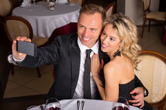 Couple taking selfie with cellphone Royalty Free Stock Photography