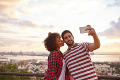 Couple taking selfie with a cellphone Royalty Free Stock Image