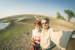 Couple taking selfie on Chobe River, Namibia Botswana border, Africa. Fisheye view from above, toned image. Chobe National Park. Famous wildlilfe reserve and royalty free stock photos