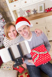 Couple taking a Selfie at Christmas Stock Photo