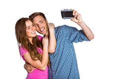 Couple taking selfie with digital camera Royalty Free Stock Photography