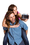 Couple taking selfie with digital camera Stock Photography