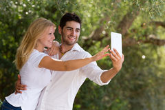 Couple taking selfie with digital tablet. Selective focus Royalty Free Stock Image