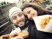 Couple while taking a Selfie eating street food Stock Images