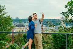 Couple taking selfie with european city on background royalty free stock image