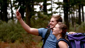 Couple taking selfie on a hike stock footage